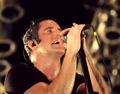 Trent Reznor appears on stage at a Nine Inch...