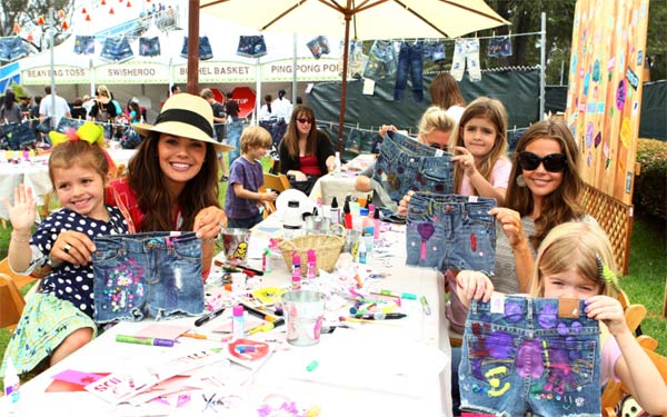 Ali Landry and her daughter Estela &#40;left&#41; and Denise Richards and her daughters Sam and Lola &#40;right&#41; appear at the &#39;Surfin&#39; Safari-themed 77kids by American Eagle Denim Decorating Booth at the 22nd annual Elizabeth Glaser Pediatric Aids Foundation &#39;A Time For Heroes&#39; Celebrity Picnic in L.A. on June 12, 2011. <span class=meta>(WireImage)</span>