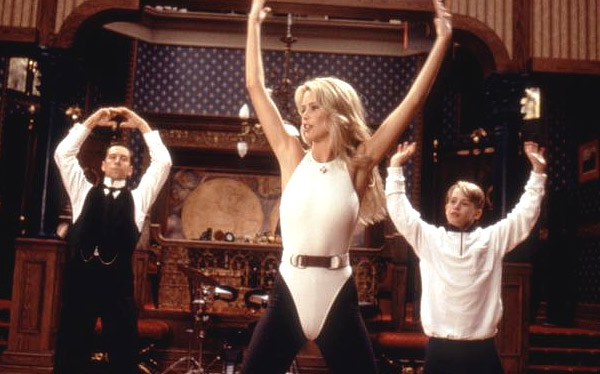 Macaulay Culkin, Jonathan Hyde and Claudia Schiffer appear as in a scene from the 1994 film 'Richie Rich.'