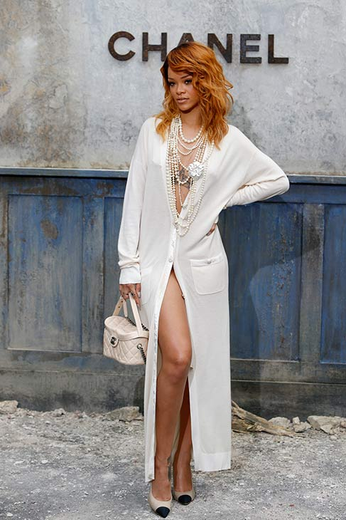 Rihanna poses for photographers as they arrive at Chanel&#39;s Haute Couture Fall-Winter 2013-2014 fashion show, presented on Tuesday, July 2, 2013 in Paris. <span class=meta>(AP Photo &#47; Francois Mori)</span>