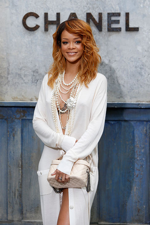 Rihanna poses for photographers as they arrive at Chanel's Haute Couture Fall-Winter 2013-2014 fashion show, presented on Tuesday, July 2, 2013 in Paris.