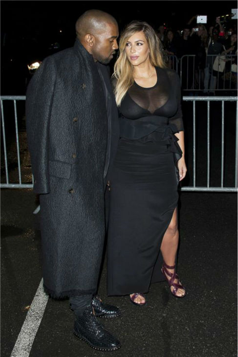 Kim Kardashian and Kanye West attend the Givenchy Spring&#47;Summer 2014 Ready-To-Wear Collection fashion show during Paris Fashion Week in Paris, France on Sept. 29, 2013. <span class=meta>(Nicolas Genin &#47; Abaca &#47; Startraksphoto.com)</span>