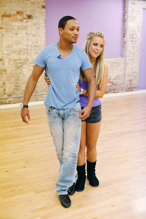 Chelsie Hightower guides her Grammy-winning partner Romeo during rehearsal for season 12 of &#39;Dancing With the Stars,&#39; which premieres on March 21 at 8 p.m. on ABC. <span class=meta>(ABC Photo&#47; Greg Zabilski)</span>