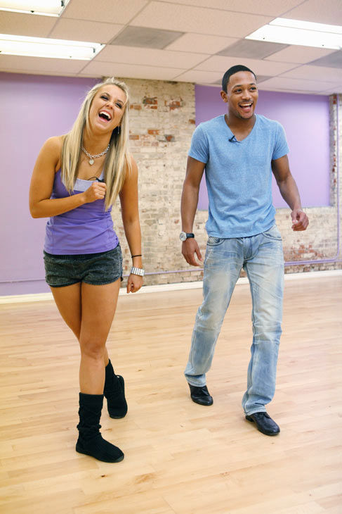 Romeo and his partner Chelsie Hightower laugh it...
