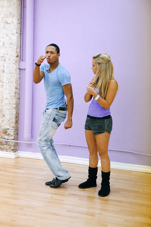 Romeo throws a punch for his partner Chelsie...