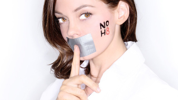 McGowan appears in a photo she did for the NOH8 campaign from their official website.