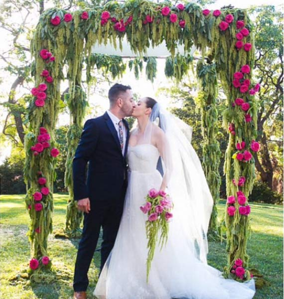 "<div class=""meta image-caption""><div class=""origin-logo origin-image ""><span></span></div><span class=""caption-text"">'Wedding pic! I designed this Chuppa out of amaranth and roses. Best day ever!' Rose McGowan posted on her Instagram page on Oct. 24, 2013.  The former 'Charmed' star wed artist Davey Detail at the Paramour Mansion in Los Angeles on Oct. 12. (instagram.com/p/f22addAYtl/ instagram.com/rosemcgowan)</span></div>"