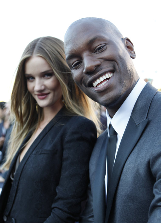 Rosie Huntington-Whiteley and Tyrese Gibson attend a 'Transformers 3: Dark of the Moon' event, which included a Linkin Park concert, in Moscow, Russia on June 23, 2011.