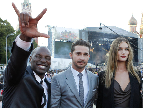 From left: Tyrese Gibson, Shia LaBeouf and Rosie Huntington-Whiteley attend a 'Transformers 3: Dark of the Moon' event, which included a Linkin Park concert, in Moscow, Russia on June 23, 2011.