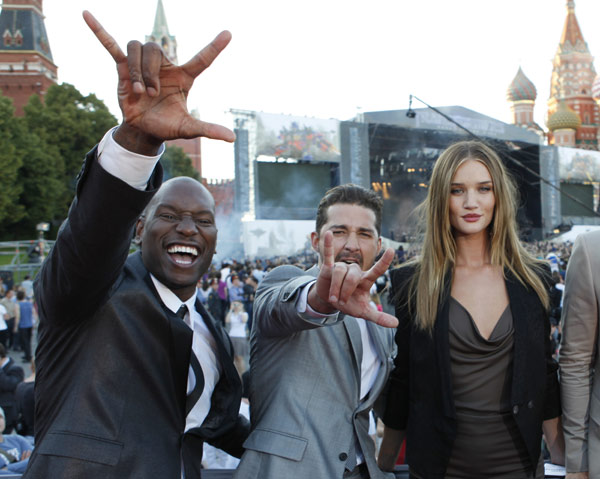 "<div class=""meta image-caption""><div class=""origin-logo origin-image ""><span></span></div><span class=""caption-text"">From left: Tyrese Gibson, Shia LaBeouf and Rosie Huntington-Whiteley attend a 'Transformers 3: Dark of the Moon' event, which included a Linkin Park concert, in Moscow, Russia on June 23, 2011. (Oleg Nikishin / Getty Images / Royalty-free)</span></div>"