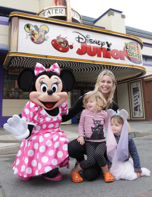 Rebecca Romijn and twin daughters, Dolly (right) and Charlie meet Minnie Mouse for the first time outside the Disney Junior Live on Stage! show at Disney California Adventure park in Anaheim, California, on Friday, Oct. 21, 2011.