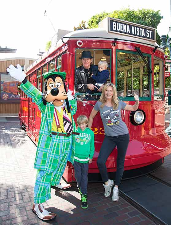 Rod Stewart, his wife Penny and their sons, Aiden, 2, and Alastair, 7, celebrate Aiden's second birthday with Goofy on the Red Car Trolley at Disney California Adventure park in Anaheim, California on Monday, Feb. 18, 2013.