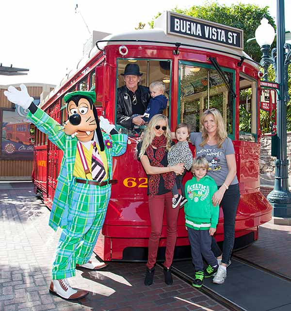 Rod Stewart, his wife Penny and their sons, Aiden, 2, and Alastair, 7, celebrate Aiden's 2nd birthday with Goofy at Disney California Adventure park in Anaheim, California on Feb. 18, 2013. Also pictured: His daughter Kimberley and daughter Delilah, 1.