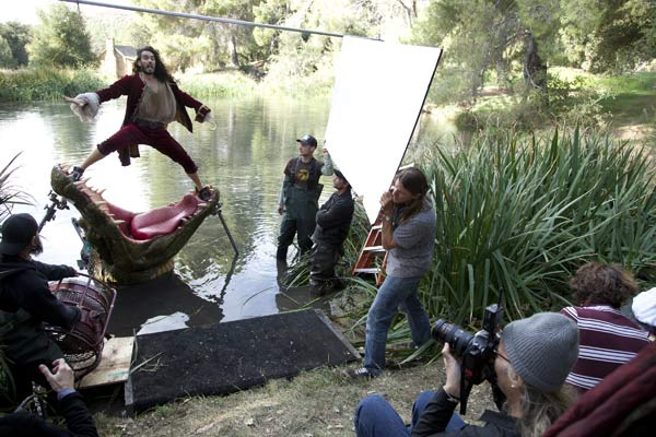 Russell Brand appears in a behind the scenes photo from his Disney Dream Portrait photo shoot with iconic photographer Annie Leibovitz. As Captain Hook, Russell Brand appears as Peter Pan&#39;s nemesis narrowly escaping the jaws of the crocodile who has chased him for years. The tagline reads, &#39;Where every moment leaves you hungry for more.&#39; <span class=meta>(Disney Enterprises Inc. &#47; Annie Leibovitz)</span>
