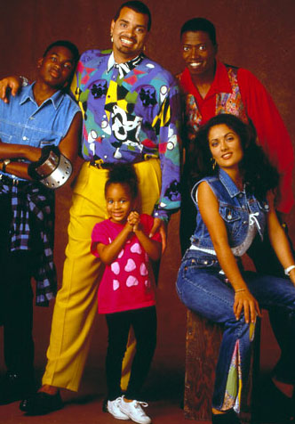 Salma Hayek appears with the cast of comedian Sinbad's sitcom 'The Sinbad Show,' which aired from 1993 to 1994, in a promotional photo.