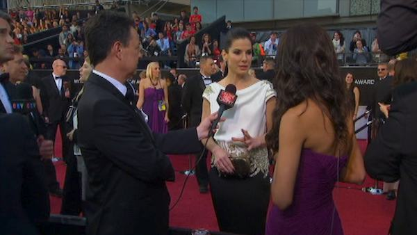 Sandra Bullock turns 48 on July 26, 2012. The actress is known for movies such as &#39;The Blind Side,&#39; &#39;The Proposal&#39; and &#39;Crash.&#39;&#40;Pictured: George Pennacchio and Rachel Smith of OnTheRedCarpet.com talk to celebrities at the Oscar pre-show on Sunday, February 26.&#41; <span class=meta>(OTRC)</span>