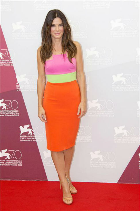 Sandra Bullock walks the red carpet at a photo call for the film &#39;Gravity&#39; at the 70th annual Venice International Film Festival on Aug. 27, 2013. She is wearing a bright pink, green and orange color block Alex Perry Resort 2014 dress, featuring a pencil skirt, and nude Giuseppe Zanotti stiletto sandals. <span class=meta>(Action Press &#47; Startraksphoto.com)</span>