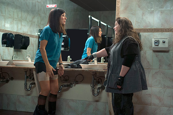 Sandra Bullock and Melissa McCarthy appear in a scene fr