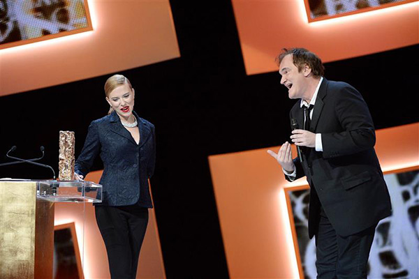 Scarlett Johansson holds her honorary Cesar Award on stage at the Cesar Film Awards in Paris on Feb. 28, 2014 as director Quentin Tarantino reacts. <span class=meta>(Bernard-Briquet-Orban &#47; ABACA &#47; Startraksphoto.com)</span>