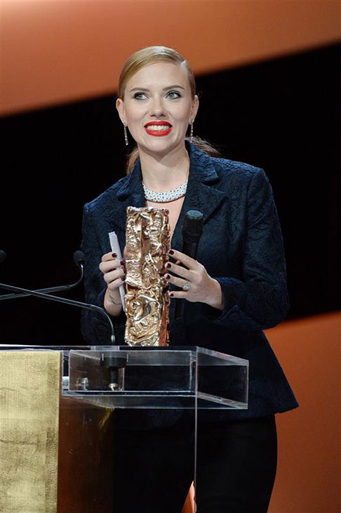 Scarlett Johansson holds her honorary Cesar Award at the Cesar Film Awards in Paris on Feb. 28, 2014. <span class=meta>(Bernard-Briquet-Orban &#47; ABACA &#47; Startraksphoto.com)</span>