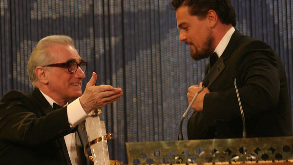 Martin Scorsese appears in a photo with Leonardo...