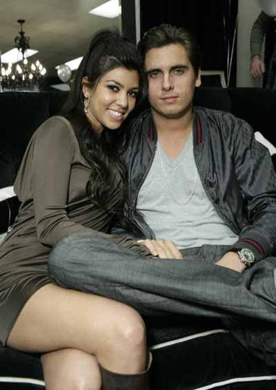 Scott Disick and Kourtney Kardashian in a ph