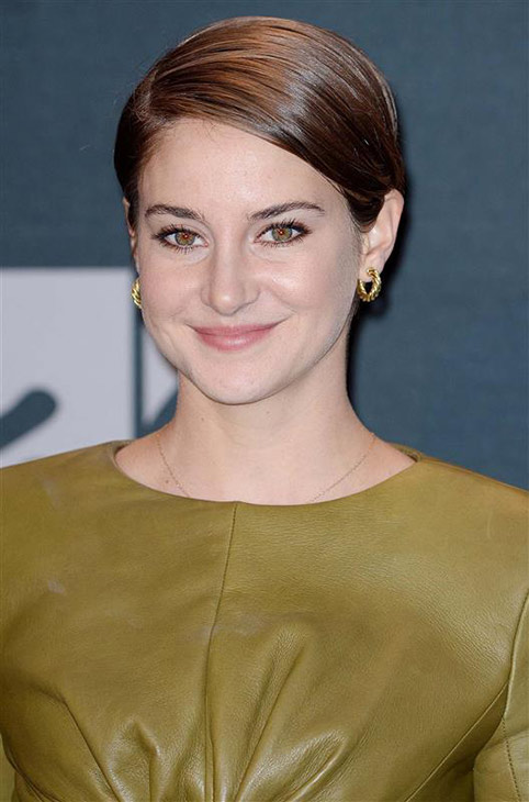 Shailene Woodley appears backstage at the 2014 MTV Movie Awards at the Nokia Theatre in Los Angeles on April 13, 2014. She won the award for Favorite Character for her role as Beatrice &#39;Tris&#39; Prior in the movie &#39;Divergent.&#39; <span class=meta>(Lionel Hahn &#47; AbacaUSA &#47; Startraksphoto.com)</span>