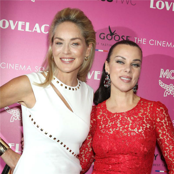 L-R: Sharon Stone and Debi Mazar attend a screening of 'Lovelace,' hosted by the Cinema Society and MCM with Grey Goose, at the Metropolitan Museum of Art (MoMa) in New York on July 30, 2013.