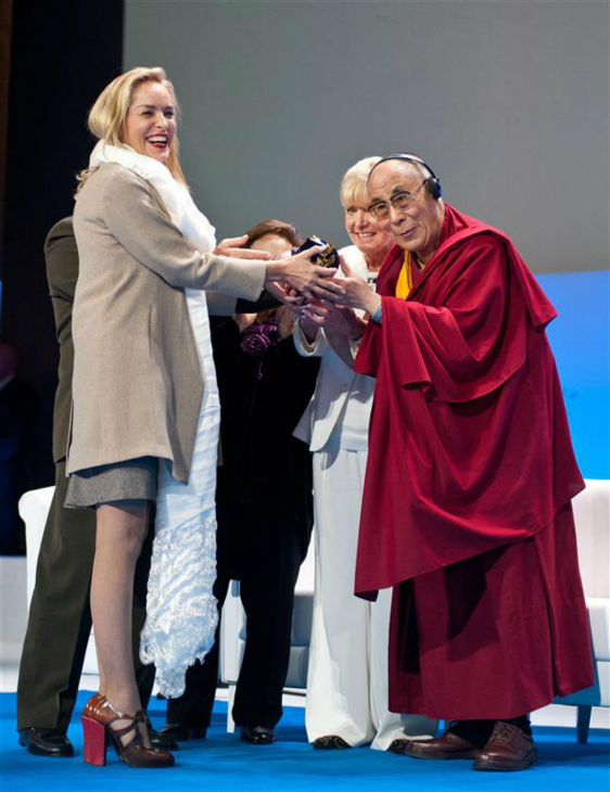 The time Sharon Stone received the 2013 Peace Summit Award from the Dalai Lama at the National Opera in Warsaw, Poland on Oct. 23, 2013.