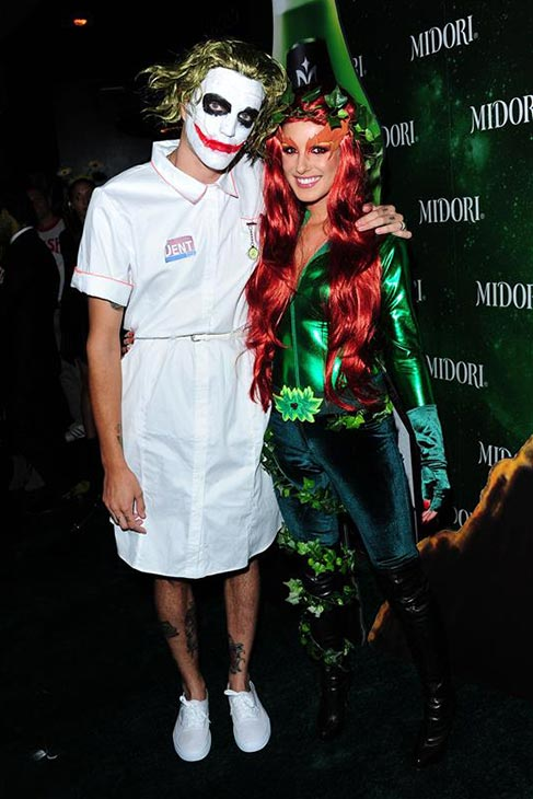 Shenae Grimes and husband Josh Beech dress up like The Joker from 'The Dark Knight' and Poison Ivy from 'Batman and Robin' at a Halloween party sponsored by Midori Green at Bootsy Bellows in Los Angeles on Oct. 29, 2013.