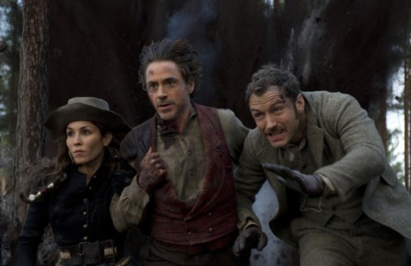 Pictured: From left, Noomi Rapace, Robert Downey Jr. and Jude Law appear in a scene from the 2011 film 'Sherlock Homes: A Game of Shadows.'