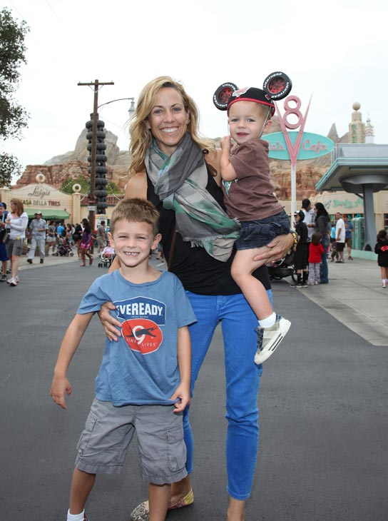 Sheryl Crow and her sons, Wyatt, 5 (left) and Levi, 2, pose at Cars Land in Disney California Adventure Park in Anaheim, California, on Wednesday, July 25, 2012.
