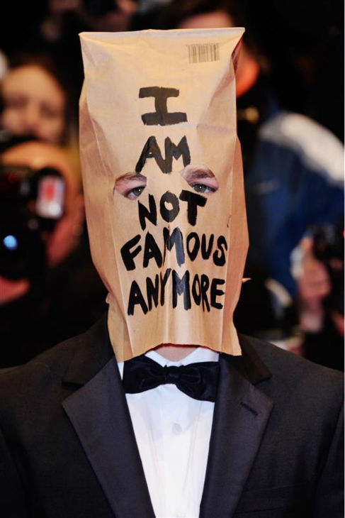 Shia LaBeouf appears with a paper bag over his head at the premiere for &#39;Nymphomaniac Volume I&#39; at the Berlin Film Festival on Feb. 9, 2014. The bag contains the words &#39;I am not famous anymore&#39; -- a phrase he has tweeted daily since January, when he declared he was retiring from public life following a plagiarism scandal. <span class=meta>(Aurore Marechal &#47; Abaca &#47; Startraksphoto.com)</span>