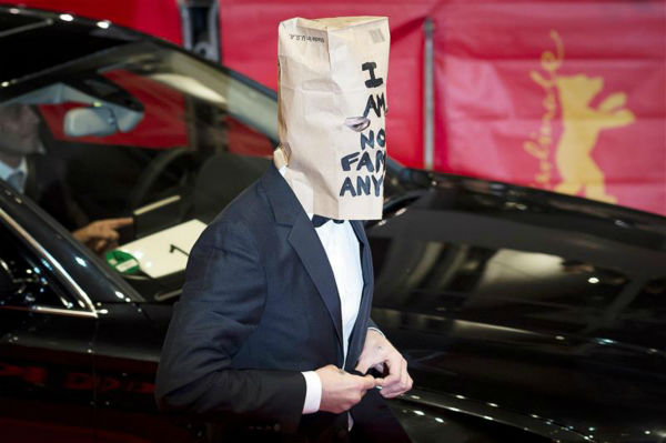 Shia LaBeouf appears with a paper bag over his head at the premiere for &#39;Nymphomaniac Volume I&#39; at the Berlin Film Festival on Feb. 9, 2014. The bag contains the words &#39;I am not famous anymore&#39; -- a phrase he has tweeted daily since January, when he declared he was retiring from public life following a plagiarism scandal. <span class=meta>(Michael Ukas &#47; Startraksphoto.com)</span>