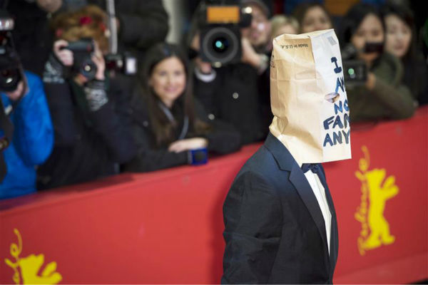 "<div class=""meta image-caption""><div class=""origin-logo origin-image ""><span></span></div><span class=""caption-text"">Shia LaBeouf appears with a paper bag over his head at the premiere for 'Nymphomaniac Volume I' at the Berlin Film Festival on Feb. 9, 2014. The bag contains the words 'I am not famous anymore' -- a phrase he has tweeted daily since January, when he declared he was retiring from public life following a plagiarism scandal. (Michael Ukas / Startraksphoto.com)</span></div>"