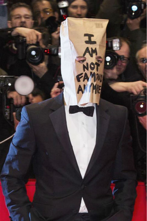 Shia LaBeouf appears with a paper bag over his head at the premiere for &#39;Nymphomaniac Volume I&#39; at the Berlin Film Festival on Feb. 9, 2014. The bag contains the words &#39;I am not famous anymore&#39; -- a phrase he has tweeted daily since January, when he declared he was retiring from public life following a plagiarism scandal. <span class=meta>(Jochen Zick &#47; Startraksphoto.com)</span>