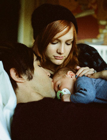 Pete Wentz and Ashlee Simpson appear with baby Bronx in a photo from Pete's official website in August 2009.