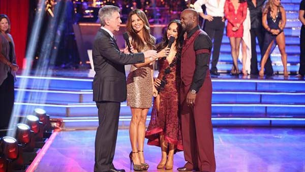 Emmitt Smith and Cheryl Burke await their fate on &#39;Dancing With The Stars: The Results Show&#39; on November 20, 2012. The pair received 27 out of 30 points from the judges for their &#39;Espionage&#39; Lindy Hop and 27 out of 30 points for their Tango. <span class=meta>(ABC Photo)</span>