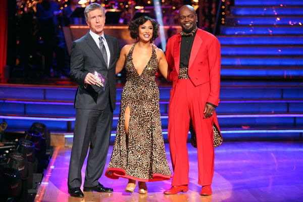 Retired NFL star Emmitt Smith and his partner Cheryl Burke rec