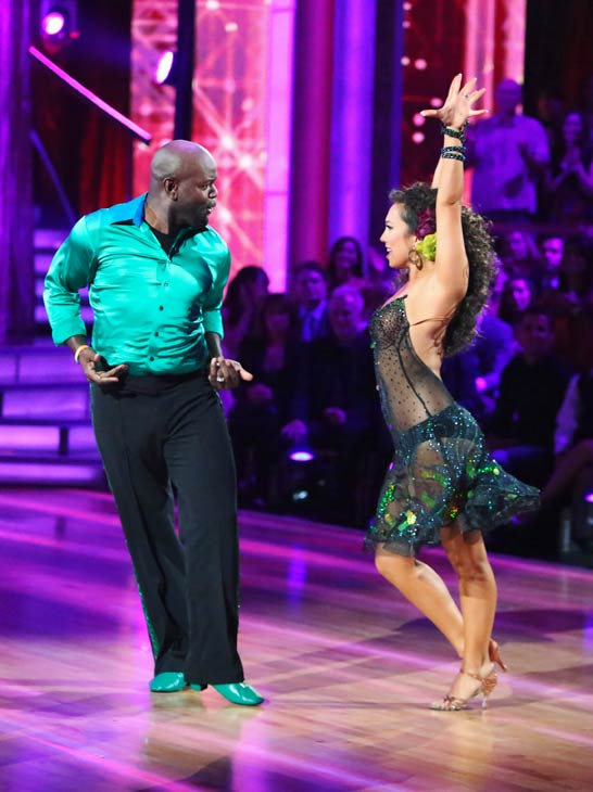 Emmitt Smith and Cheryl Burke appear in a stil