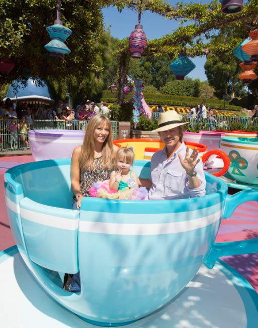 David Spade, Playboy Playmate Jillian Grace and their daughter Harper, 3,sit in a tea cup on the Mad Tea Party ride at Disneyland in Anaheim, California on Sept. 1, 2011. The two brought their little girl to the theme park to celebrate her 3rd birthday, which occurred last week. <span class=meta>(Paul Hiffmeyer &#47; Disneyland)</span>