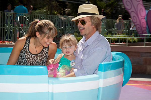 David Spade, Playboy Playmate Jillian Grace and their daughter Harper, 3, sit in a tea cup on the Mad Tea Party ride at Disneyland in Anaheim, California on Sept. 1, 2011.