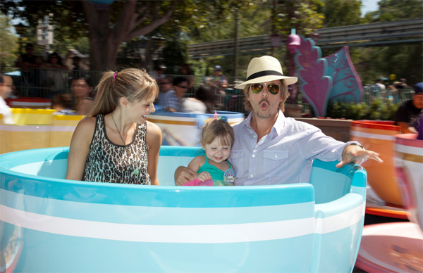"<div class=""meta ""><span class=""caption-text "">David Spade, Playboy Playmate Jillian Grace and their daughter Harper, 3, sit in a tea cup on the Mad Tea Party ride at Disneyland in Anaheim, California on Sept. 1, 2011. (Paul Hiffmeyer / Disneyland)</span></div>"