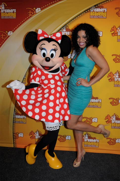 'American Idol' winner Jordin Sparks poses with Minnie Mouse at Walt Disney World at Lake Buena Vista, Florida on March 11, 2012.