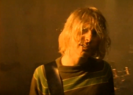 "<div class=""meta image-caption""><div class=""origin-logo origin-image ""><span></span></div><span class=""caption-text"">Kurt Cobain told Rolling Stone in 1994 that the line 'Here we are now, entertain us' from the hit song 'Smells Like Teen Spirit' 'came from something I used to say every time I used to walk into a party to break the ice.' 'A lot of times, when you're standing around with people in a room, it's really boring and uncomfortable,' he said. 'So it was 'Well, here we are, entertain us. You invited us here.' (Pictured: Kurt Cobain appears in a scene from the music video 'Smells Like Teen Spirit.') (Geffen Records)</span></div>"