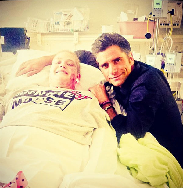 John Stamos poses with California woman Kaitlyn Dobrow, an amputee, at her hospital bedside, as seen in this photo the actor posted on Instagram on Aug. 6, 2013. - Provided courtesy of instagram.com/p/crngG_Ch4R/ instagram.com/johnstamos