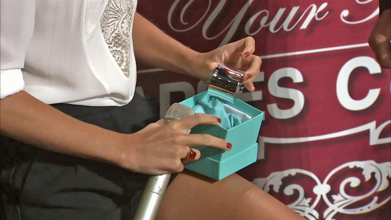 Taylor Swift Is Presented With A Tiffany Cuff Bracelet From Los Angeles Staples Center Senior