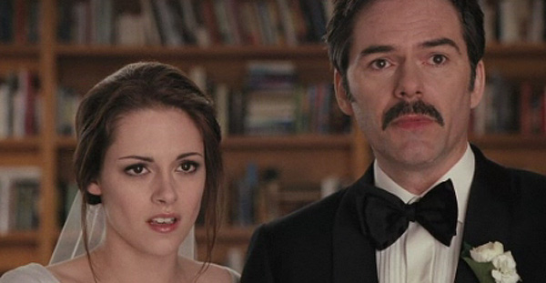 Kristen Stewart appears as Bella Swan and Billy Burke appears as her father in a scene from 'The Twilight Saga: Breaking Dawn - Part 1.'