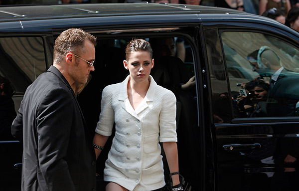Kristen Stewart leaves after attending Chanel's Haute Couture Fall-Winter 2013-2014 fashion show, presented on Tuesday, July 2, 2013 in Paris.