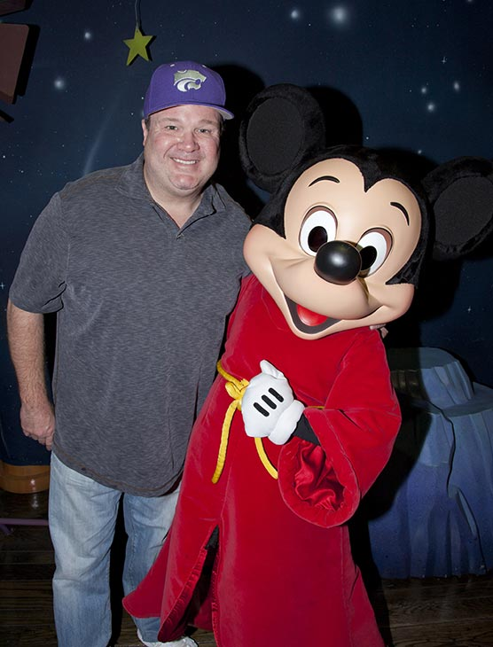 'Modern Family' star Eric Stonestreet meets Mickey Mouse at Disneyland in Anaheim, California on Thursday, Jan. 16, 2014.